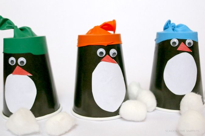 Penguins made out of paper cups with little balloon hats.