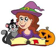 Cat and witch reading.