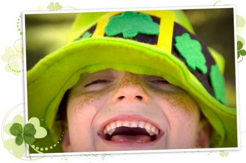 Smiling child with a St. Patrick's Day hat